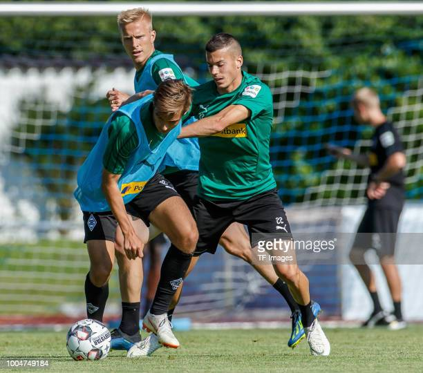 Florian Neuhaus of Borussia Moenchengladbach and Laszlo Benes of Borussia Moenchengladbach battle for the ball during the Borussia Moenchengladbach...