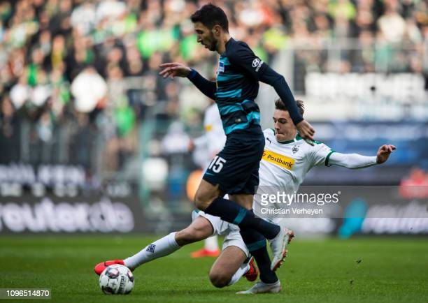 Florian Neuhaus of Borussia Moenchengladbach and Marko Grujic of Hertha BSC battle for the ball during the Bundesliga match between Borussia...