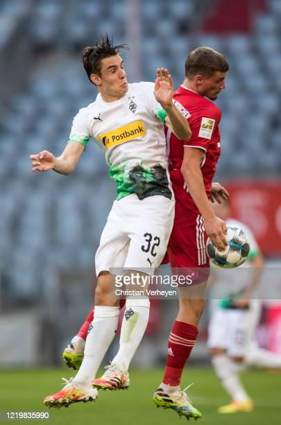 Florian Neuhaus of Borussia Moenchengladbach and Michael Cuisance of FC Bayern München battle for the ball during the Bundesliga match between FC...