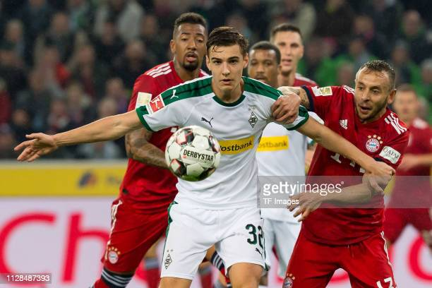 Florian Neuhaus of Borussia Moenchengladbach and Rafinha of Bayern Muenchen battle for the ball during the Bundesliga match between Borussia...
