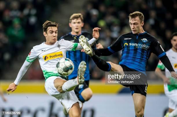 Florian Neuhaus of Borussia Moenchengladbach and Sebastian Schonlau of SC Paderborn battle for the ball during the Bundesliga match between Borussia...