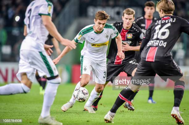 Florian Neuhaus of Borussia Moenchengladbach and Tin Jedvaj of Bayer 04 Leverkusen battle for the ball during the DFB Cup match between Borussia...