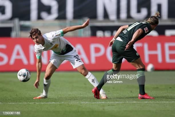 Florian Neuhaus of Borussia Moenchengladbach competes for the ball with Felix Klaus of VfL Wolfsburg during the Bundesliga match between Borussia...