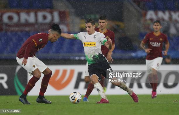 Florian Neuhaus of Borussia Moenchengladbach in action against AS Roma players during the UEFA Europa League group J match between AS Roma and...