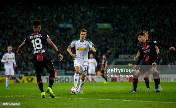 Florian Neuhaus of Borussia Moenchengladbach in action during the DFB Cup match between Borussia Moenchengladbach and Bayer 04 Leverkusen at...