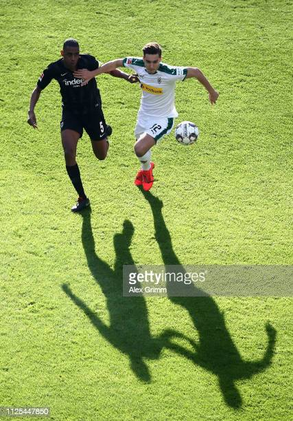 Florian Neuhaus of Borussia Moenchengladbach is challenged by Gelson Fernandes of Eintracht Frankfurt during the Bundesliga match between Eintracht...