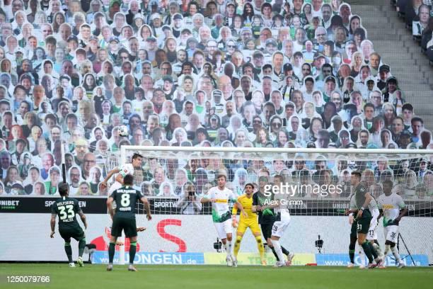 Florian Neuhaus of Borussia Moenchengladbach jumps for a header during the Bundesliga match between Borussia Moenchengladbach and VfL Wolfsburg at...