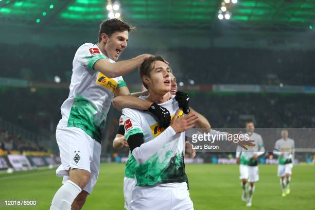 Florian Neuhaus of Borussia Monchengladbach celebrates after scoring his team's third goal during the Bundesliga match between Borussia...