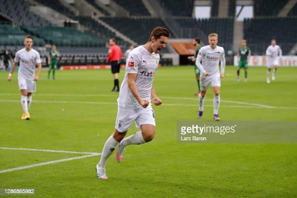 Florian Neuhaus of Borussia Monchengladbach celebrates after scoring his team's first goal during the Bundesliga match between Borussia...