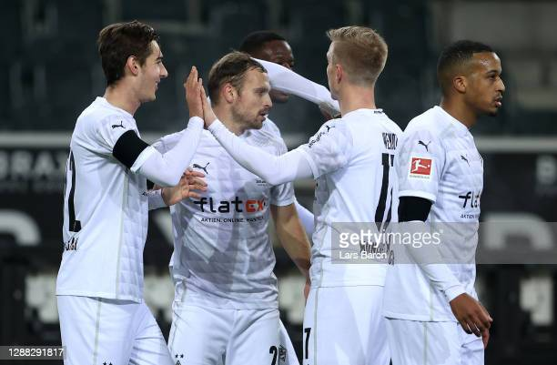 Florian Neuhaus of Borussia Monchengladbach celebrates with teammate Oscar Wendt after scoring his team's first goal during the Bundesliga match...