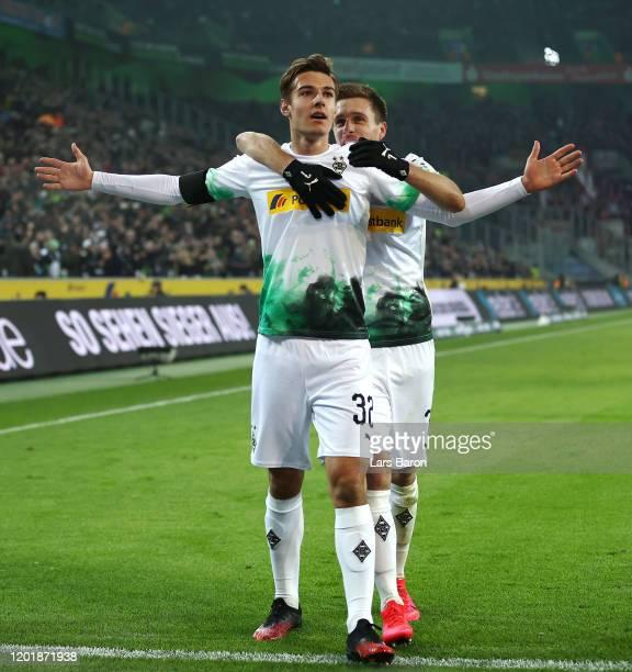 Florian Neuhaus of Borussia Monchengladbach celebrates with teammates after scoring his team's third goal during the Bundesliga match between...
