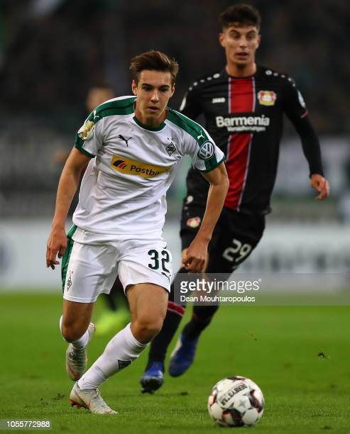 Florian Neuhaus of Borussia Monchengladbach holds off Kai Havertz of Bayer Leverkusen during the DFB Cup match between Borussia Moenchengladbach and...