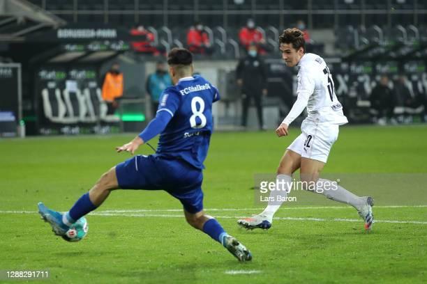 Florian Neuhaus of Borussia Monchengladbach scores his team's first goal during the Bundesliga match between Borussia Moenchengladbach and FC Schalke...
