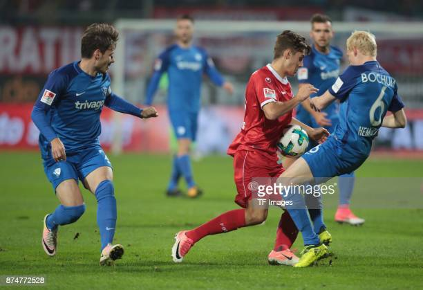 Florian Neuhaus of Duesseldorf and Stefano Celozzi of Bochum battle for the ball during the Second Bundesliga match between VfL Bochum 1848 and...