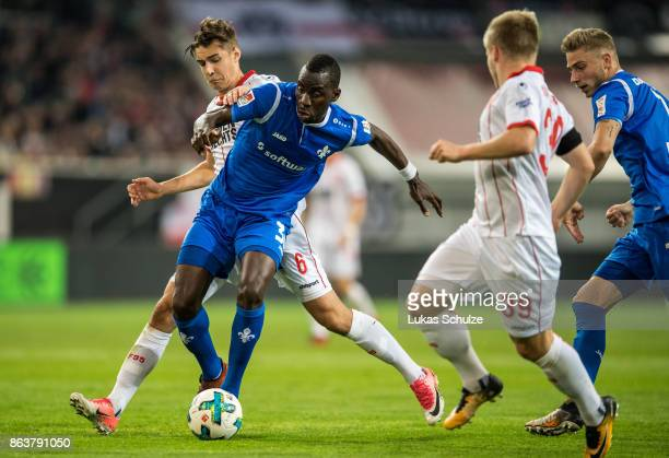 Florian Neuhaus of Duesseldorf and Wilson Kamavuaka Wilson Kamavuaka of Darmstadt fight for the ball during the Second Bundesliga match between...