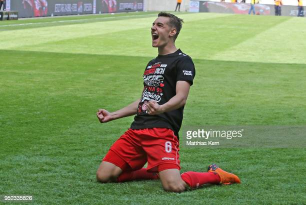 Florian Neuhaus of Duesseldorf jubilates after moving up into the Bundesliga after the Second Bundesliga match between SG Dynamo Dresden and Fortuna...