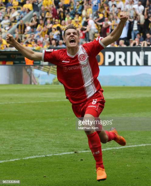 Florian Neuhaus of Duesseldorf jubilates and moves into the Bundesliga during the Second Bundesliga match between SG Dynamo Dresden and Fortuna...