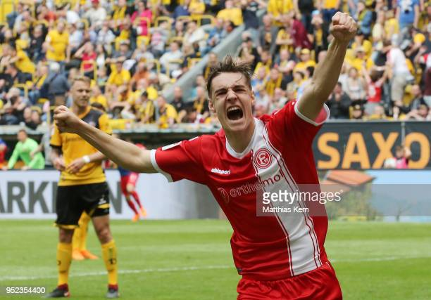 Florian Neuhaus of Duesseldorf jubilates and moves up into the Bundesliga after the Second Bundesliga match between SG Dynamo Dresden and Fortuna...