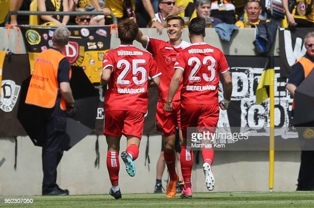 Florian Neuhaus of Duesseldorf jubilates with team mates after scoring the first goal during the Second Bundesliga match between SG Dynamo Dresden...