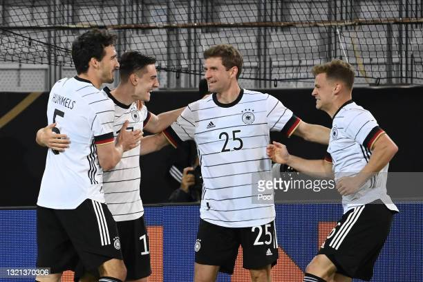Florian Neuhaus of Germany celebrates with Mats Hummels and Thomas Muller after scoring their side's first goal during the international friendly...