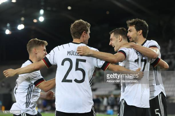 Florian Neuhaus of Germany celebrates with Thomas Muller after scoring their side's first goal during the international friendly match between...