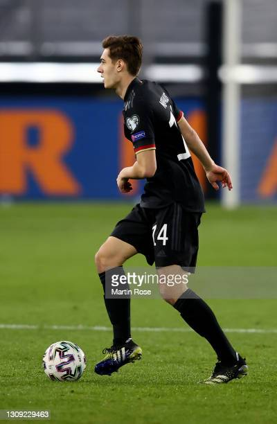 Florian Neuhaus of Germany runs with the ball during the FIFA World Cup 2022 Qatar qualifying match between Germany and Iceland on March 25, 2021 in...
