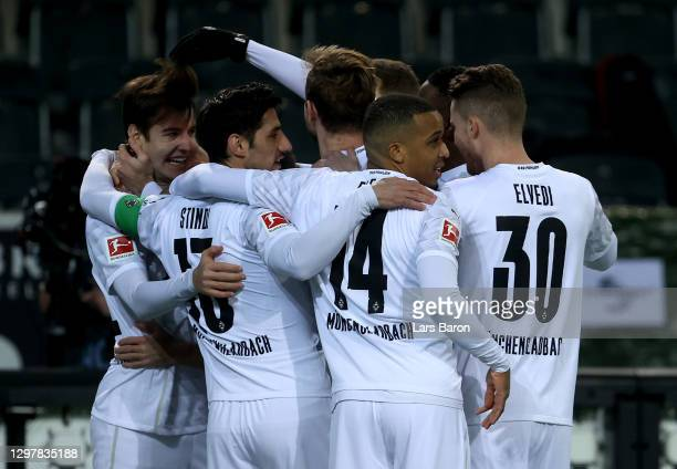 Florian Neuhaus of Gladbach celebrate with his team mates after he scores the opening goal during the Bundesliga match between Borussia...
