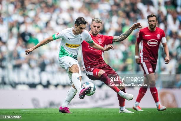 Florian Neuhaus of Mönchengladbach and Andre Hoffmann of Düsseldorf in action during the Bundesliga match between Borussia Mönchengladbach and...