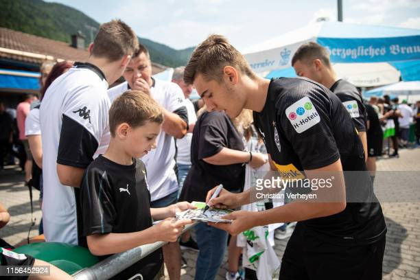 Florian Neuhaus sign for a Fan after a training session at the Borussia Moenchengladbach Training Camp on July 19, 2019 in Rottach-Egern, Germany.
