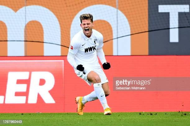 Florian Niederlechner of Augsburg celebrates after scoring their team's first goal during the Bundesliga match between FC Augsburg and 1. FC Union...