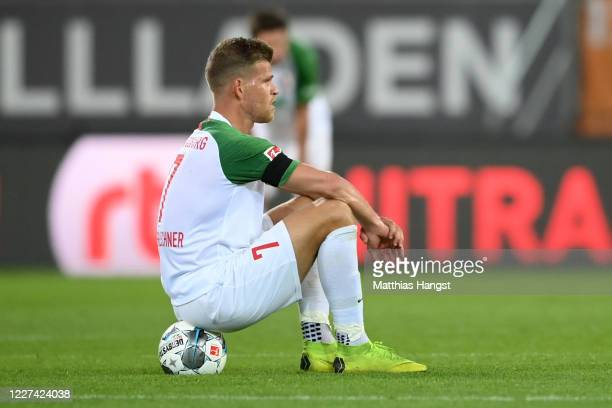Florian Niederlechner of Augsburg reacts after the Bundesliga match between FC Augsburg and SC Paderborn 07 at WWK-Arena on May 27, 2020 in Augsburg,...