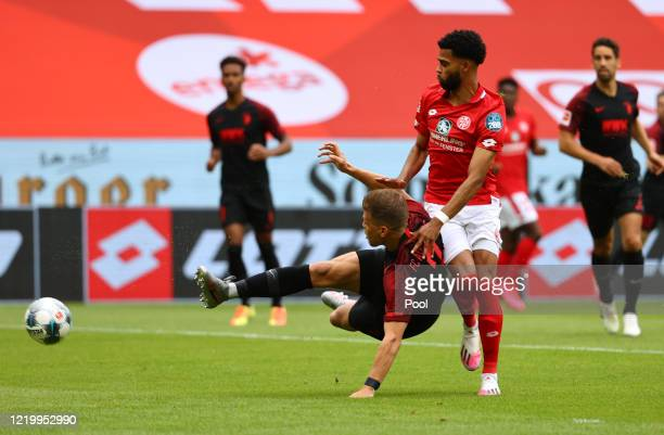 Florian Niederlechner of Augsburg scores their first goal during the Bundesliga match between 1. FSV Mainz 05 and FC Augsburg at Opel Arena on June...