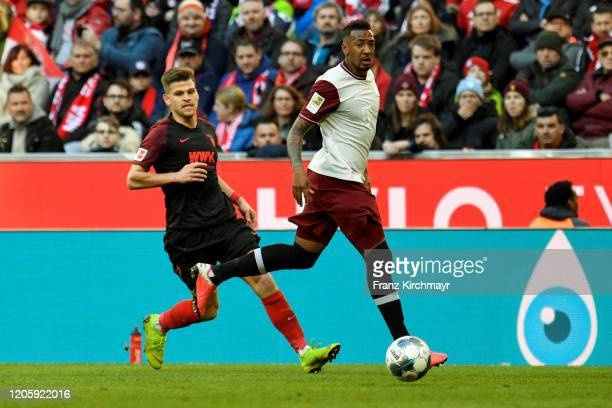 Florian Niederlechner of FC Augsburg and Jerome Agyenim Boateng of Bayern Muenchen during the Bundesliga match between FC Bayern Muenchen and FC...