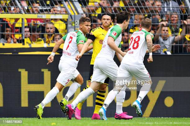 Florian Niederlechner of FC Augsburg celebrates scoring the opening goal during the Bundesliga match between Borussia Dortmund and FC Augsburg at...