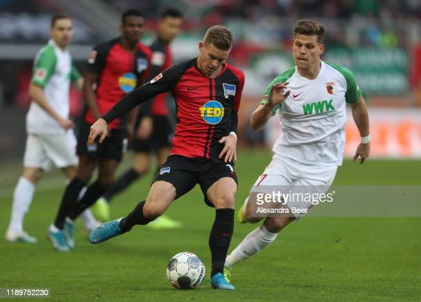 Florian Niederlechner of FC Augsburg fights for the ball with Maximilian Mittelstaedt of Hertha BSC during the Bundesliga match between FC Augsburg...