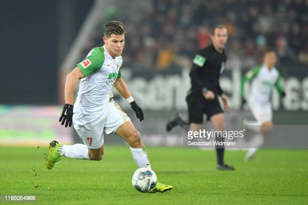 Florian Niederlechner of FC Augsburg plays the ball during the Bundesliga match between FC Augsburg and Fortuna Duesseldorf at WWK-Arena on December...