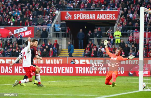 Florian Niederlechner of FC Augsburg scores his team's first goal during the Bundesliga match between 1 FC Koeln and FC Augsburg at...