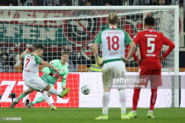 Florian Niederlechner of FC Augsburg scores his team's second goal from the penalty spot during the Bundesliga match between FC Augsburg and 1. FSV...