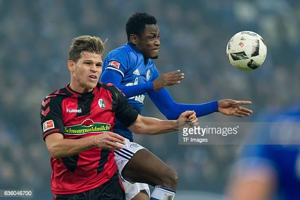 Florian Niederlechner of Freiburg and Abdul Rahman Baba of Schalke battle for the ball during the Bundesliga match between FC Schalke 04 and SC...
