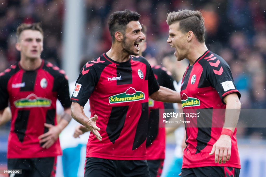 Florian Niederlechner of Freiburg (R) celebrates his team's second goal with team mate Onur Bulut during the Bundesliga match between SC Freiburg and FC Schalke 04 at Schwarzwald-Stadion on May 7, 2017 in Freiburg im Breisgau, Germany.
