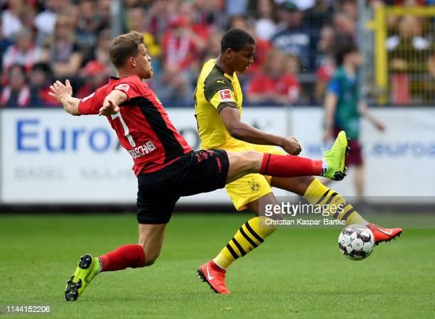 Florian Niederlechner of Freiburg challenges Manuel Akanji of Dortmund during the Bundesliga match between SportClub Freiburg and Borussia Dortmund...
