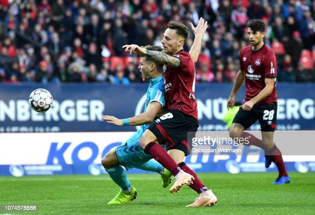 Florian Niederlechner of Freiburg is challenged by Robert Bauer of Nuernberg during the Bundesliga match between 1 FC Nuernberg and SportClub...