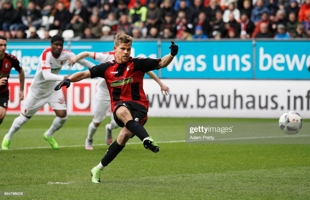 Florian Niederlechner of Freiburg scores a penalty goal during the Bundesliga match between FC Augsburg and SC Freiburg at WWK Arena on March 18, 2017 in Augsburg, Germany.