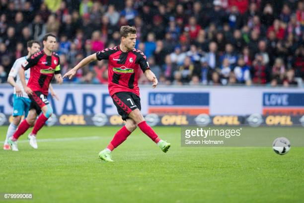 Florian Niederlechner of Freiburg scores his team's second goal with a penalty kick during the Bundesliga match between SC Freiburg and FC Schalke 04...