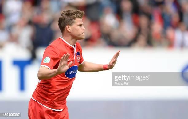 Florian Niederlechner of Heidenheim celebrates after scoring the opening/first goal during the Third League match between 1. FC Heidenheim and SpVgg...