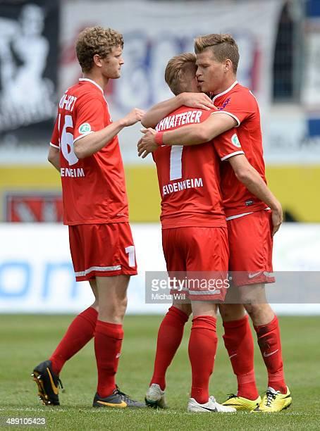 Florian Niederlechner of Heidenheim celebrates with team-mates after scoring the opening/first goal during the Third League match between 1. FC...