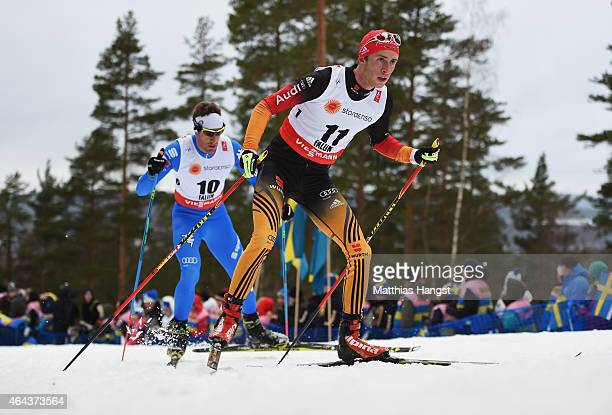 Florian Notz of Germany competes with David Hofer of Italy during the Men's 15km CrossCountry during the FIS Nordic World Ski Championships at the...