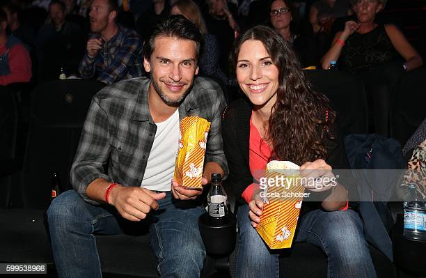 Florian Odendahl and EvaMaria Reichert with popcorn during the premiere for the film 'Maennertag' at Mathaeser Filmpalast on September 5 2016 in...