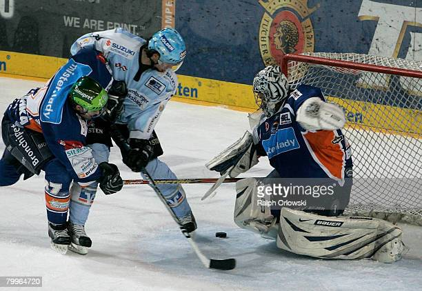 Florian Ondruschka of Nuremberg tackles Christoph Brandnder of Hamburg during the DEL match between Sinupret Ice Tigers and Hamburg Freezers at the...