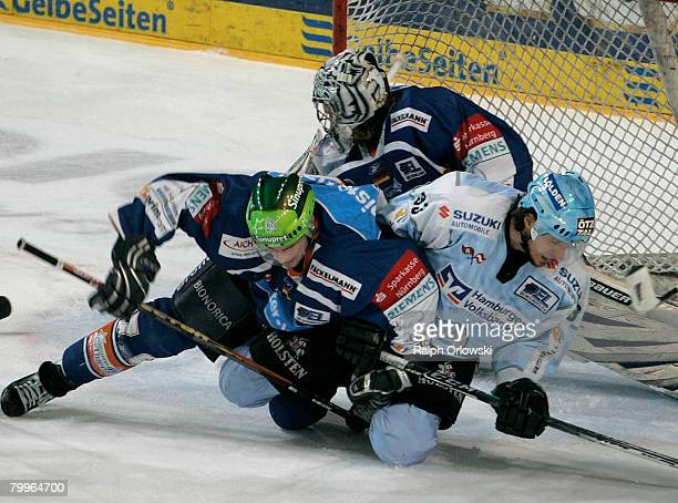 Florian Ondruschka of Nuremberg tackles Christoph Brandner of Hamburg during the DEL match between Sinupret Ice Tigers and Hamburg Freezers at the...